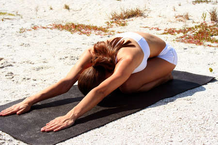 Attractive woman on beach doing yoga poses Stock Photo - 840285