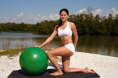 Attractive woman on beach working out with a balance ball Stock Photo - 840283