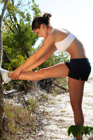 Attractive woman stretching out on the beach Stock Photo - 840250