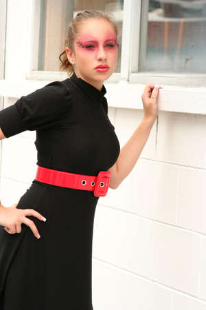 Young model wearing a black dress and goth makeup