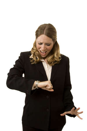 Businesswoman on white looking at watch with a look of shock