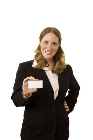 businesscard: Businesswoman on white holding a blank businesscard towards camera Stock Photo