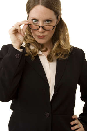 Businesswoman isolated on white looking over glasses into camera photo