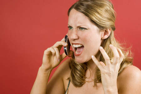 Young woman on red yelling into cell phone