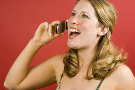 converse: Young woman on red laughing into cell phone