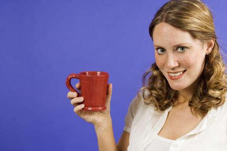 Young woman holding a coffee mug Stock Photo - 1385248