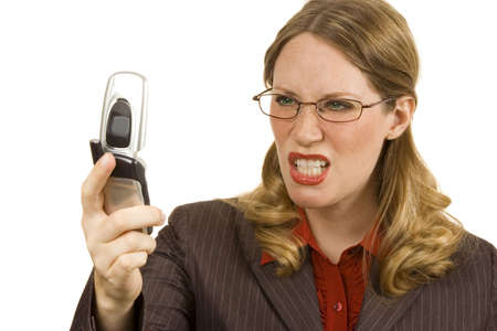 Businesswoman on white looking angryly at cell phone Stock Photo - 1355276