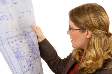 Contractor on white looking at blueprints