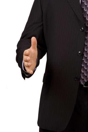 hand held: Closeup di uomo d'affari della mano tesa per la stretta di mano