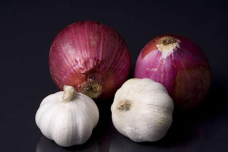 florets: Onion and garlic on black