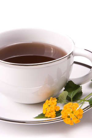 Close up of tea cup on white with a yellow flower Stock Photo - 4035339