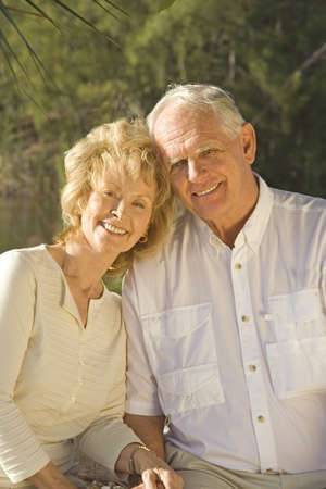 Happy senior couple sitting in a park. Stock Photo - 4056104