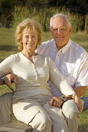 Happy senior couple sitting in a park. Banco de Imagens - 4056103