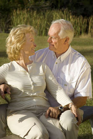 Happy senior couple sitting in a park. Stock Photo - 4056109