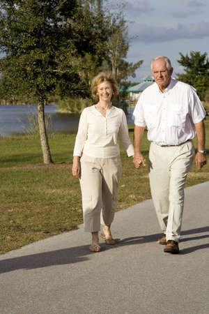 Happy senior couple walking in a park Stock Photo - 4056110
