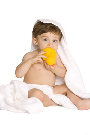 Baby in diaper with yellow duck on a white background photo
