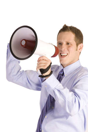 Young businessman shouting into a megaphone on white background. photo