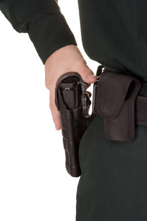 holster: Cierre de la polic�a de la mano de su pistola. Foto de archivo