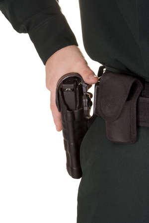 Close of of policemans hand on his gun. Stock fotó