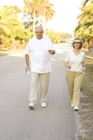 Happy senior couple walking in a neighborhood