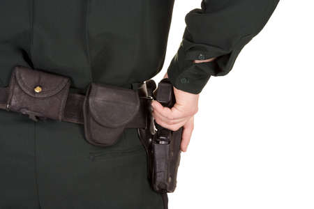Close of policemans hand on his gun.