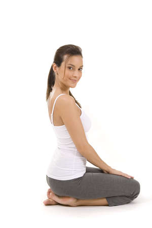 Young woman on white background in a fitness pose Imagens