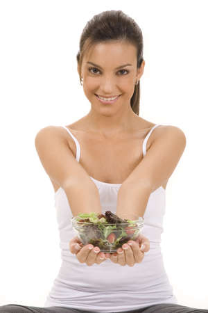 Young woman on white background with a salad Stock Photo - 5088614