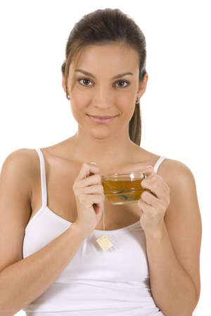 Young woman on white background with a cup of tea Stock Photo - 5088590