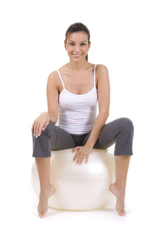 Young woman on white background in a fitness pose Stock Photo - 5088557