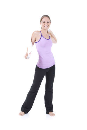 Young woman on white background in a fitness pose Stock Photo - 5088591