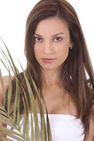 Young woman on white holding green leaves. Stock Photo - 5088599