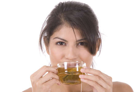 Young woman on white with a cup of tea. Stock Photo - 5088583