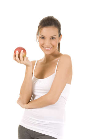 Young woman on white holding an apple