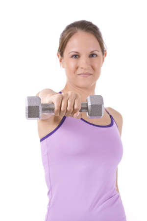 Woman on white background holding silver dumbbells.