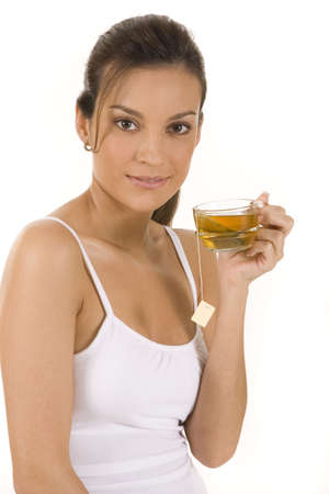 Young woman on white background with a cup of tea photo