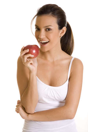 Young woman on white holding an apple. Stock Photo - 5160308