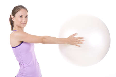 Young woman on white background in a fitness pose Stock Photo - 5160339