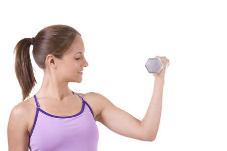 curls: Woman on white holding silver dumbbells doing curls. Stock Photo