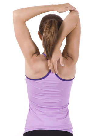tricep: Young woman on white background in a fitness pose Stock Photo