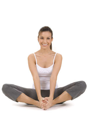 Young woman on white background in a fitness po Stock Photo
