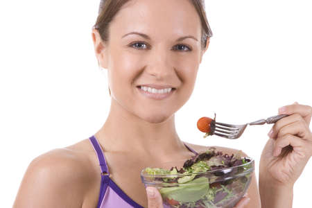 Young woman on white background with a salad Stock Photo - 5178278
