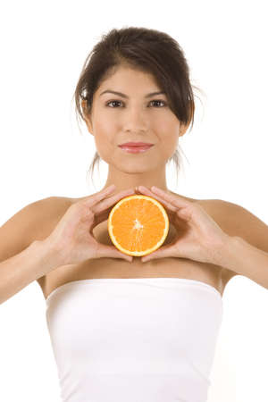 Young woman on white background with an orange. Stock Photo - 5178296