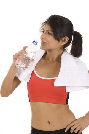 Young woman on white background in a fitness pose with water Stock Photo - 5178313