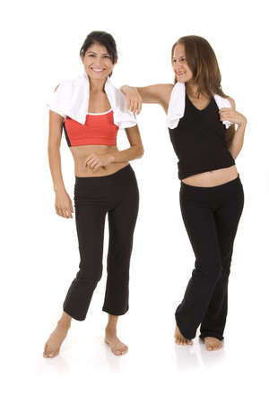 Young women on white background in a fitness pose Imagens