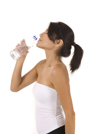 Woman drinking water on white photo