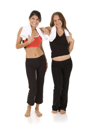 Young women on white background in a fitness pose Stock Photo