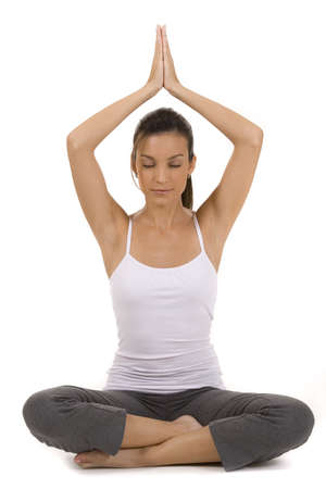 Young woman on white background in a fitness pose  Stock Photo