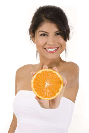 Young woman on white background with an orange.