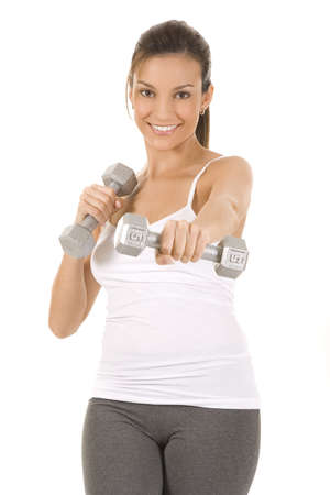 curls: Woman on white holding silver dumbbells to camera.  Stock Photo