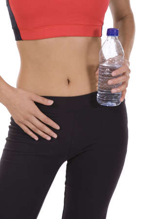 Woman in fitness pose holding a water bottle  photo
